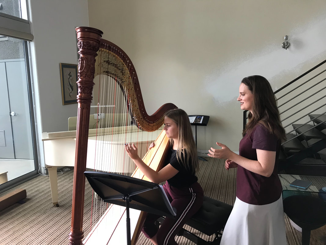 Kristie teaching a harp lesson at her studio in the Summerlin neighborhood of Las Vegas.